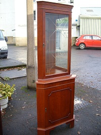 Cupboard cherry veneered, fronted with 2 glass shelves and mirrors. Good solid condition. Price: £90