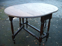 c.1930 dining or kitchen  solid oak 4-seater table, country style table with drop leaf gate leg  Price ‎£150